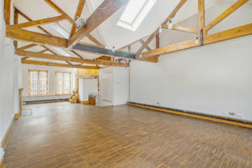 Large office with wooden flooring and small staircase on 14 & 14A Clerkenwell Green, Clerkenwell, London let by Anton Page
