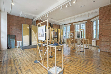 Office with brick walls and wooden flooring on 7-9 Woodbridge Street, Clerkenwell, London let by Anton Page