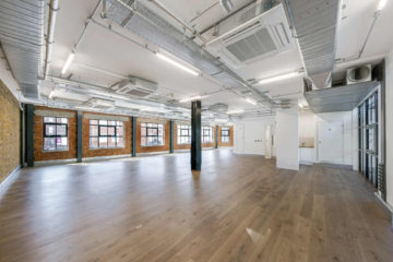 Bright commercial property with brick walls and wooden floors on 61-67 Old Street, London
