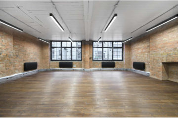 Bright Brick walls commercial property with wooden flooring at Archer Street Studios in Soho, London